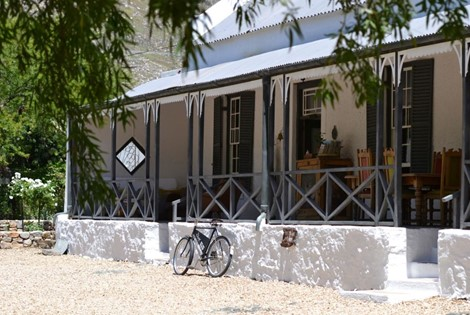 An 1835 Cape Dutch Farmhouse and outbuildings at the edge of the town, infused with great personality